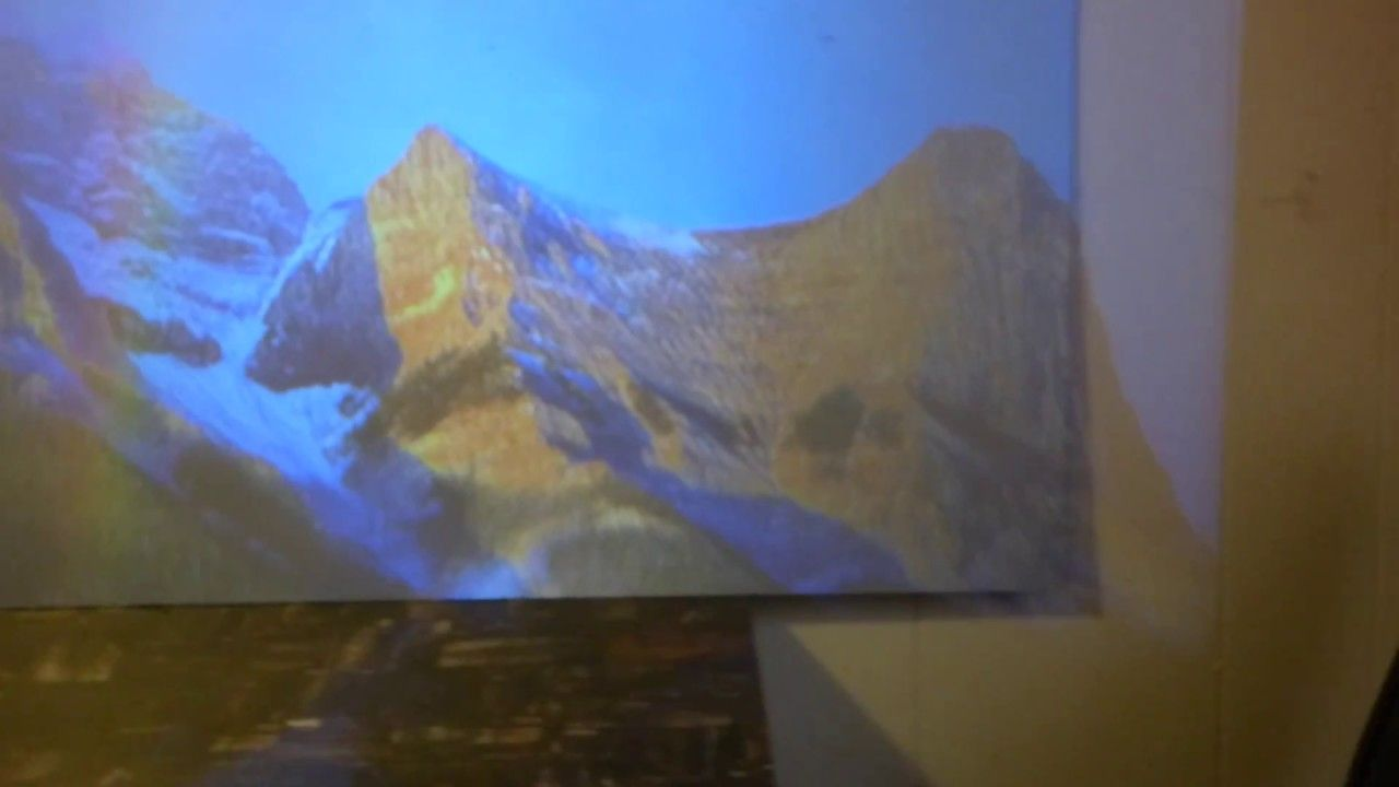 CHEAP KNOCK OFF $65 PROJECTOR ON OUR FUSION SILVER CRYSTAL VISION SCREENS!