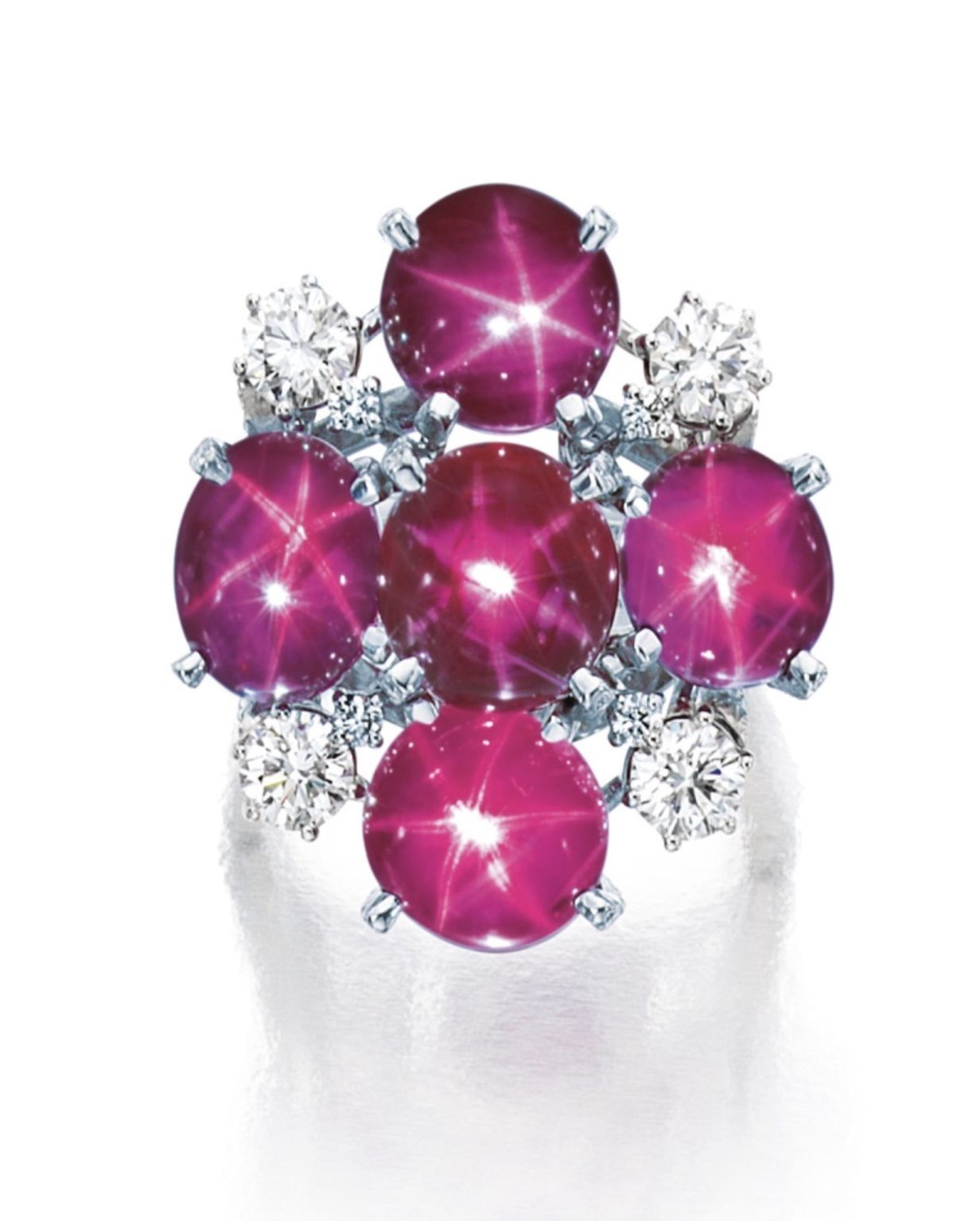 Star Ruby and Diamond Ring. Designed as a cluster of cabochon star ...