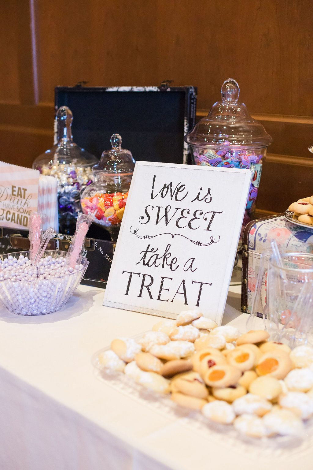 Candy table in grand ball room with desserts cookies and candy candy table in grand ball room with desserts cookies and candy in clear vases reviewsmspy