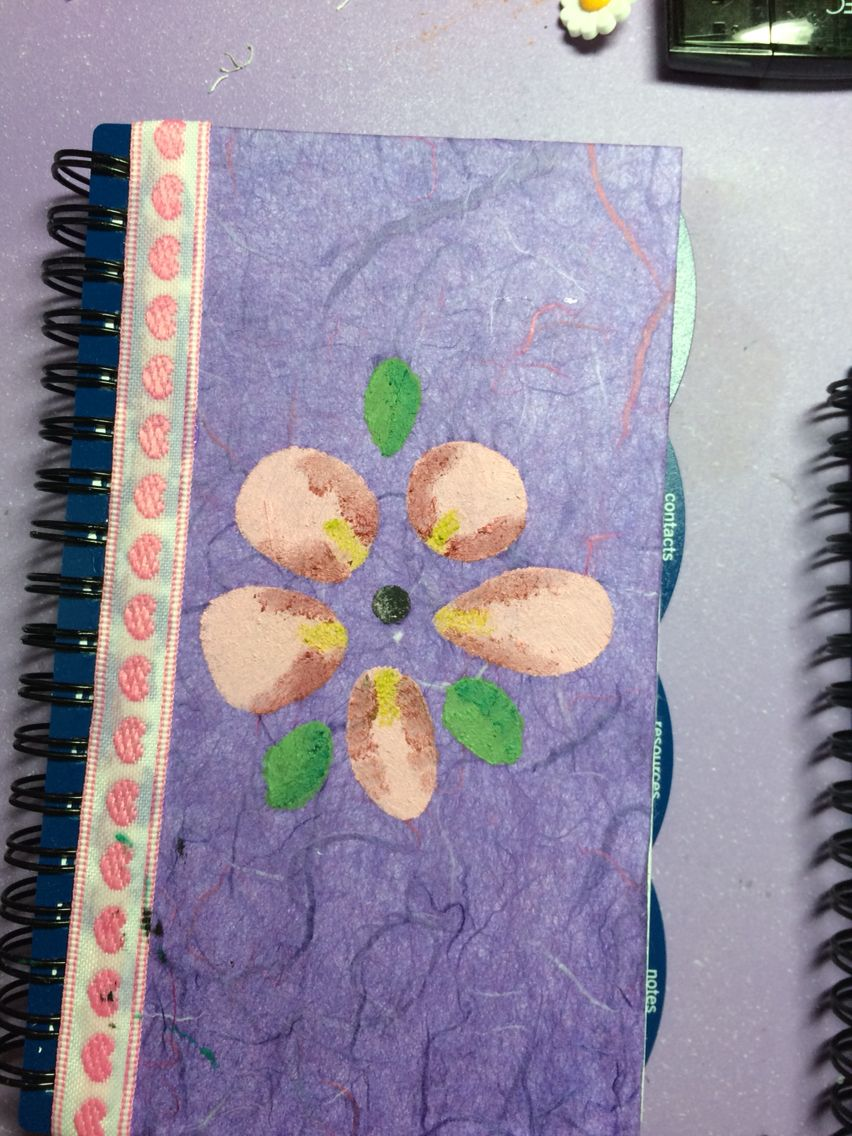 Simple planner cover. Home made type paper, ribbon, paint