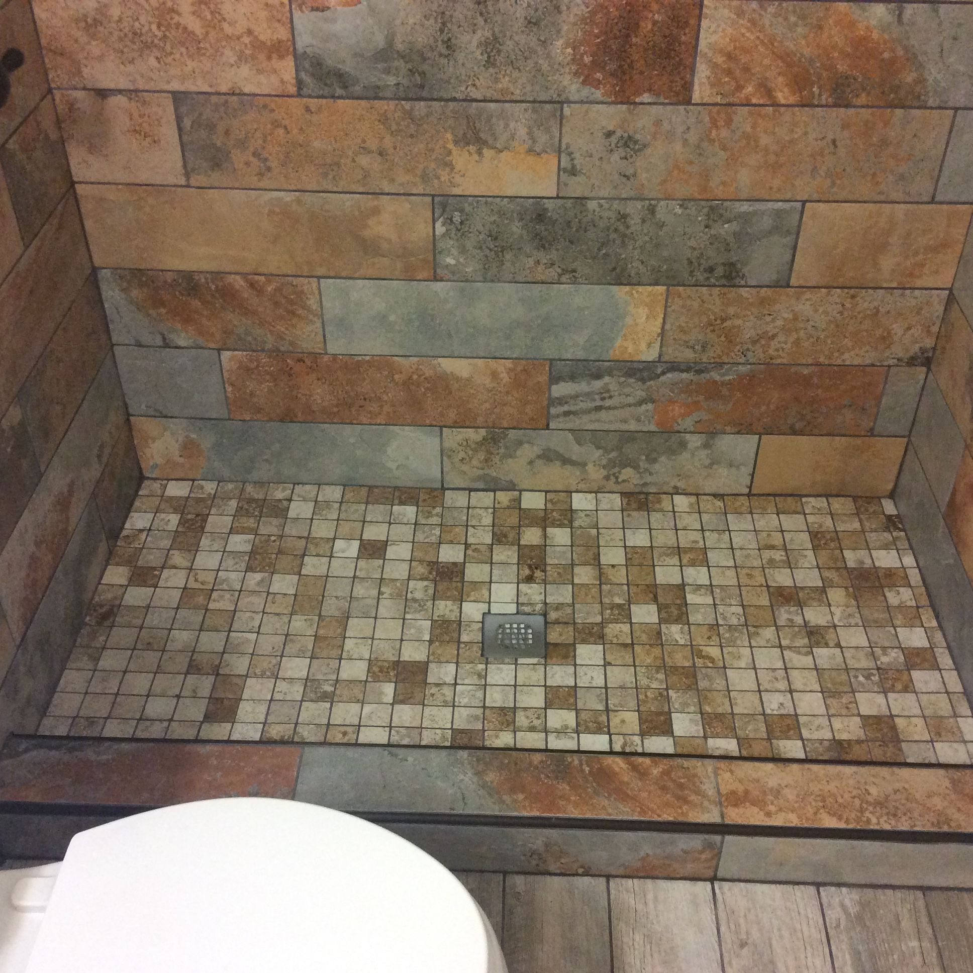 We installed slate tiles with mosaic shower base and weathered we installed slate tiles with mosaic shower base and weathered wood look ceramic tile floor doublecrazyfo Choice Image