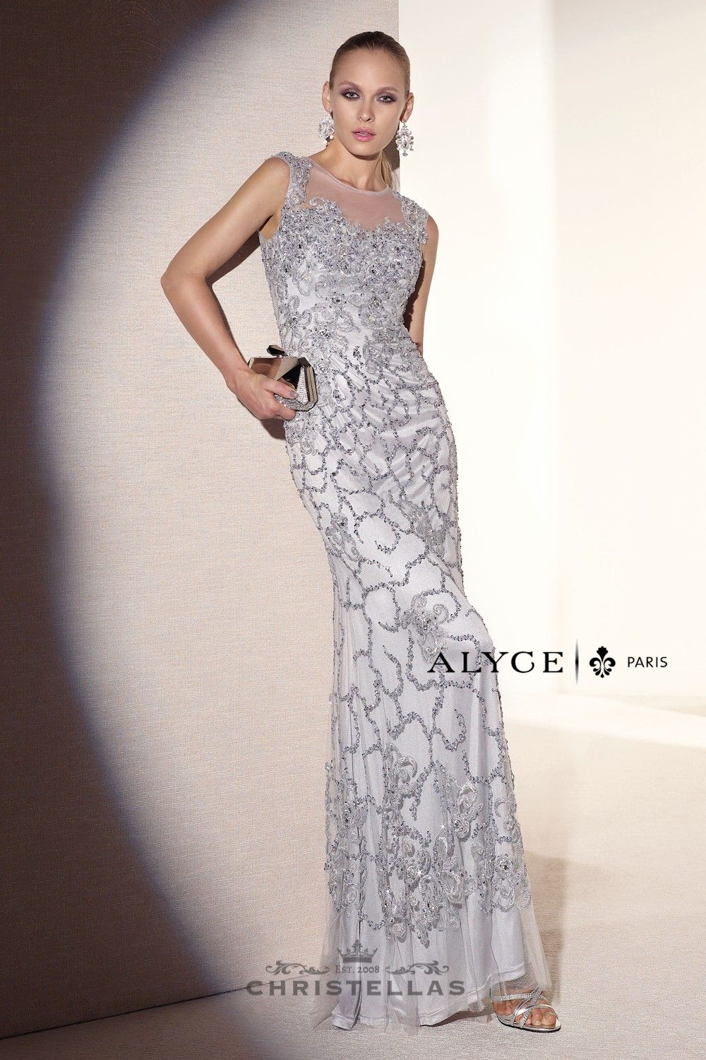 a wonderful long slim line dress with intricate beading pattern