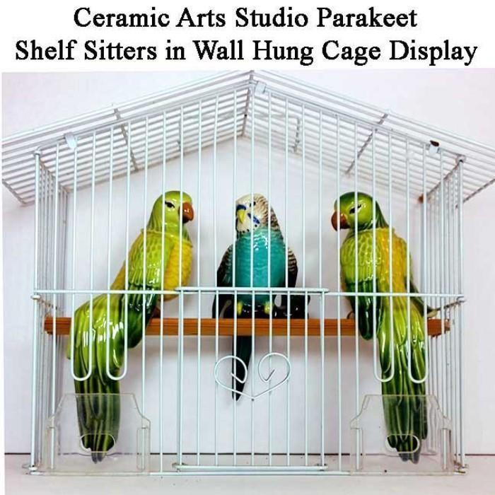 Found on EstateSales.NET: Ceramic Arts Studio Figurines Shelf Sitter Parakeets with Cage Displays