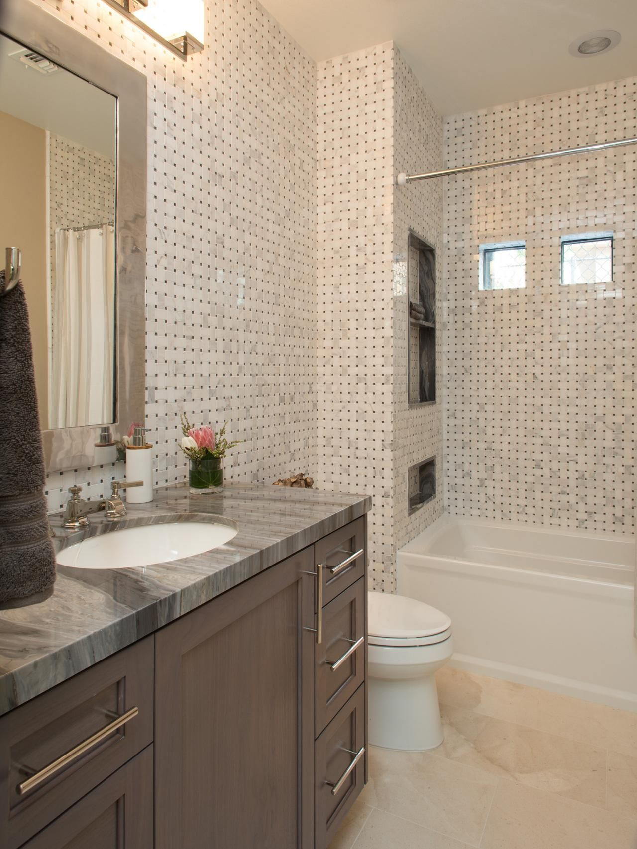 Sleek Tiled Bathroom With Gray Granite Countertops Property Brothers At Home Property Brothers Bathrooms Remodel