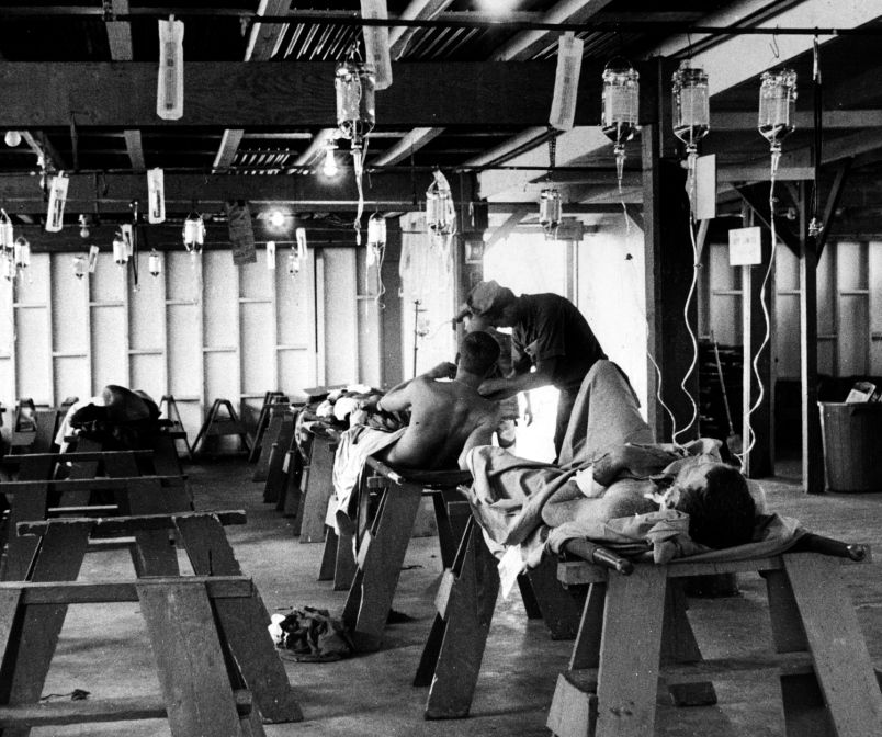 Da Nang, South Vietnam, June, 1968: Wounded servicemembers are treated in the receiving ward before being taken inside the Naval Support Activity Hospital, Da Nang, for further examination. The largest casualty receiving hospital in South Vietnam had a staff of more than 800 officers and enlisted personnel. During a 10-month period ending in May, 1968, 17,000 patients were admitted; of those, 6,000 were battle casualties who received a total of more than 18,000 operations.