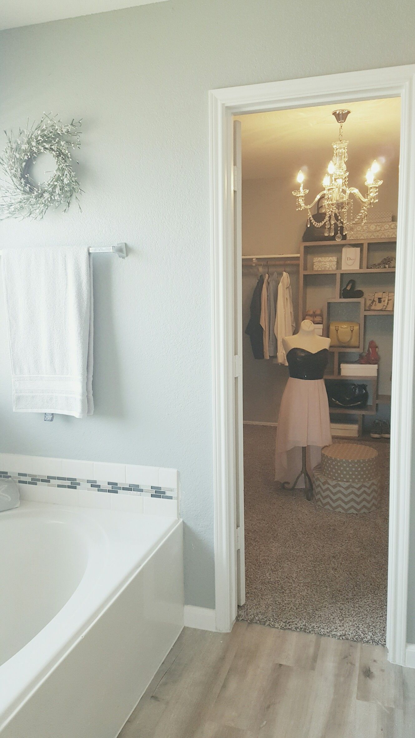 Master closet, chandelier, staged to sell. | Closet makeover