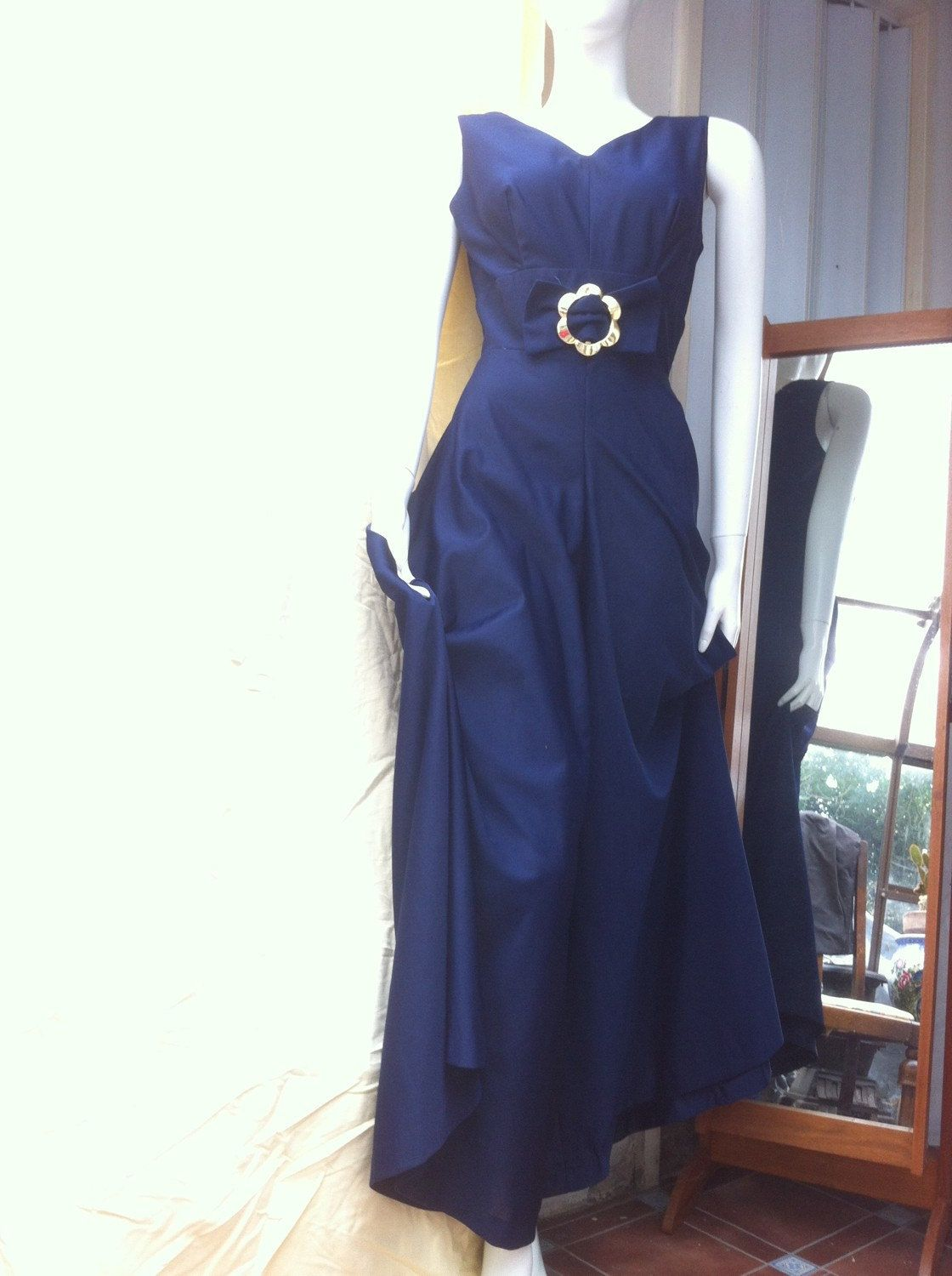 A personal favourite from my Etsy shop https://www.etsy.com/uk/listing/457057084/elegant-1970s-navy-blue-wide-palazzo