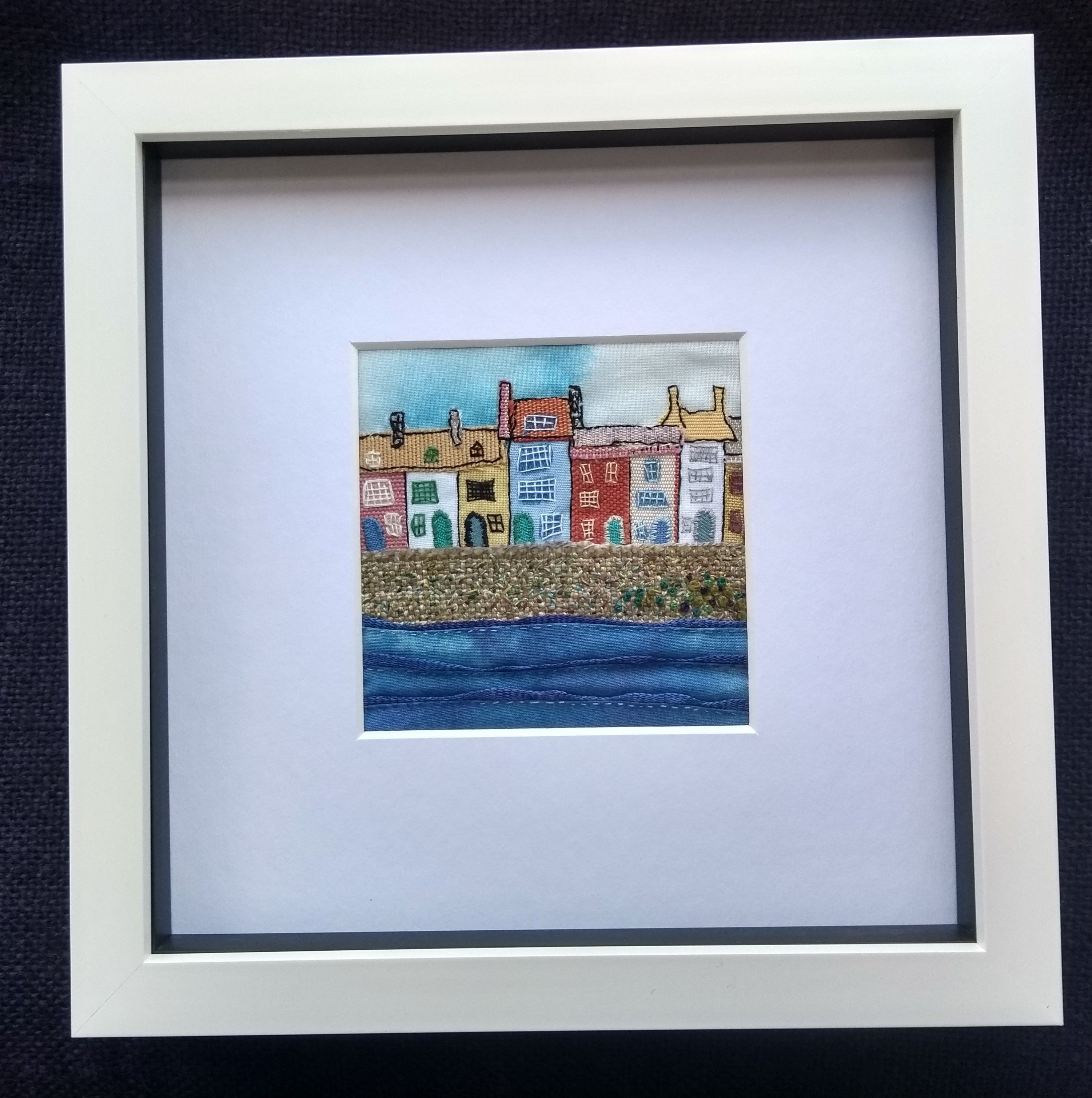 This 9cm x 9cm square of layered fabric and stitch is titled 'Harbourside Houses'.  Available with or without mount and frame.  #textileartist #fibreartist #textileart #embroideryart #stitchedart #fabricartist #fibreart #handstitched #slowstitching #artforthehome #artforsale #buyart #buyartonline #etsyshop #etsyseller #miniclothtales #affordableart #originalart #originalartforsale