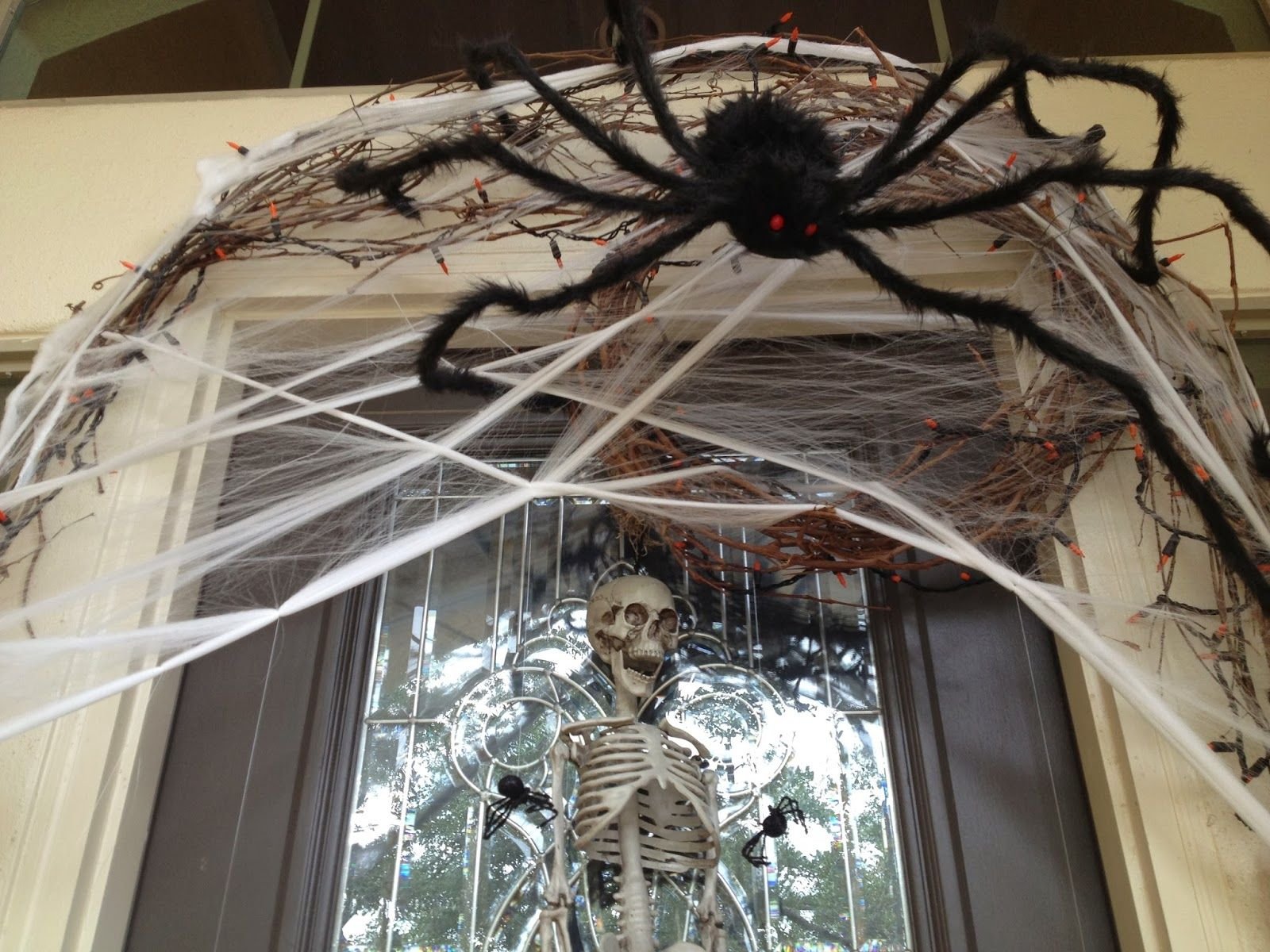 Exceptional Spider Webs Halloween Decorations Part - 7: A Big Black Spider With White Spider Web On The Cream Wall Combined With  Glass Windows With Skull. Surprising Easy Outdoor Halloween Decorations  Giving A ...