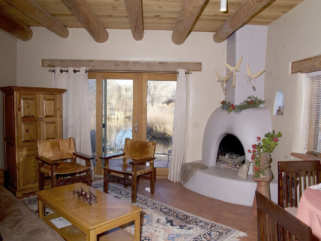 Chimayo house rental - Living Room with Kiva Firep looking out ...