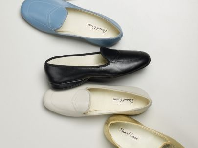 f8ede4aea39d6 A bedroom slipper with meticulously styled stitching and a breathable  lining