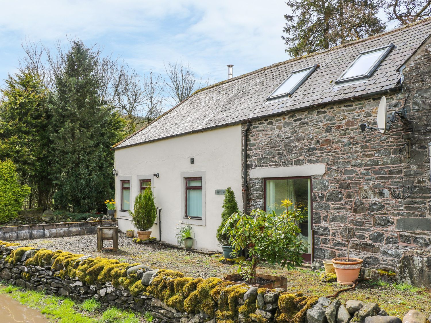 This semidetached cottage is located near the village of