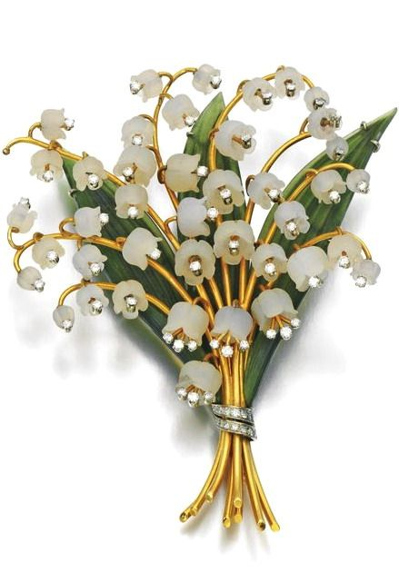 Rock crystal, nephrite and diamond brooch, 1960s Designed as a bouquet of Lilly of the Valley, with carved rock crystal flowers, enhanced with brilliant- and single-cut diamonds, with carved nephrite leaves, one diamond deficient.
