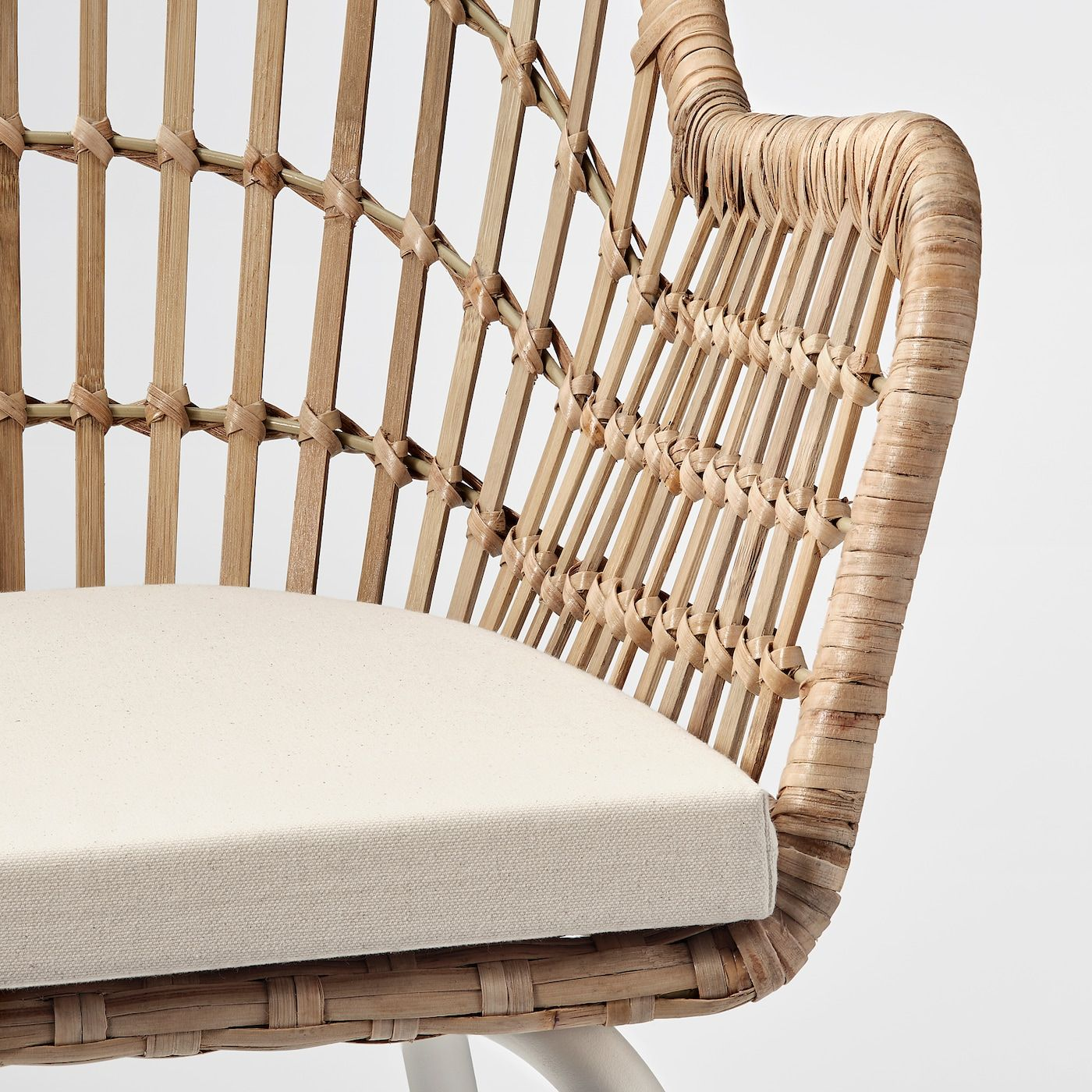 Hand-woven by experienced craftspeople, which makes each chair unique with their rounded shapes and detailed patterns. Rattan and bamboo are natural materials which age beautifully and develop their own unique characters over time. The armrest is designed to provide support when you lean back and allows you to sit close to the table when eating. The seat shell has a closed woven seat to bear more weight, and a backrest designed to create an airy and clean look. Lightweight, easy to lift and move