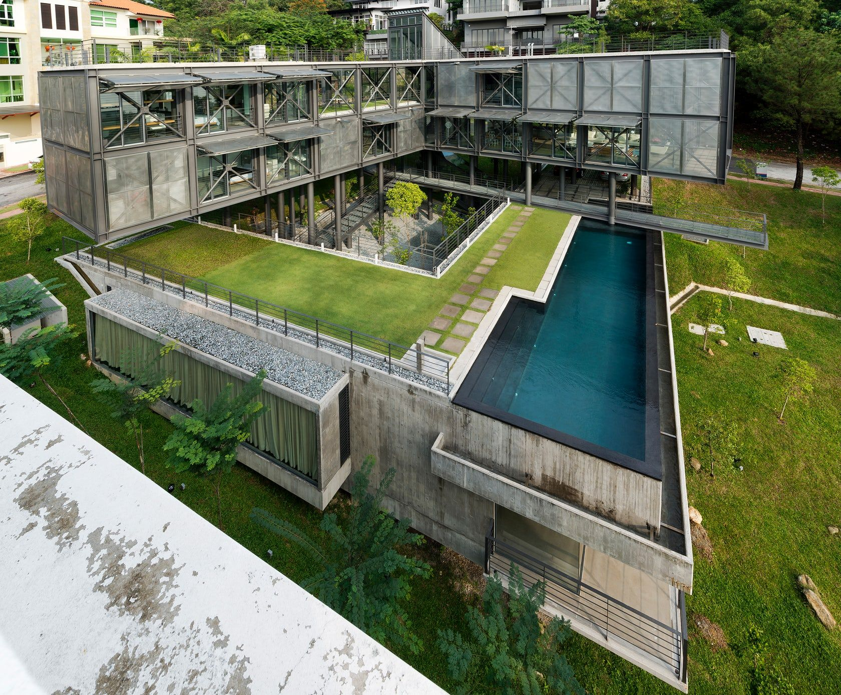 The Steeply Sloping Site For This 7000sf House, Orientated Approximately  East West, Falls
