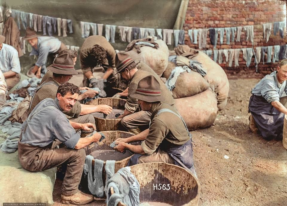 New Zealand soldiers washing socks in wooden tubs near the New Zealand Divisional Headquarters at Bus-les-artois, 7 May 1918