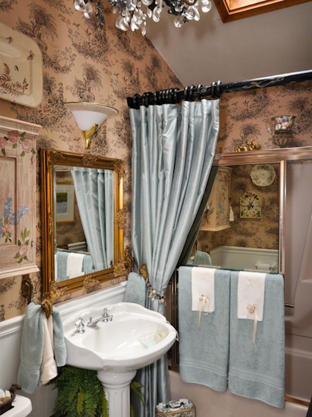 This elegant bathroom sports tan and black toile wallpaper, a black ...