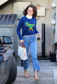 Girl loves her some colored lenses! Selena Gomez was spotted wearing flared jeans, a turtleneck, and a graphic sweater while out and about in LA.