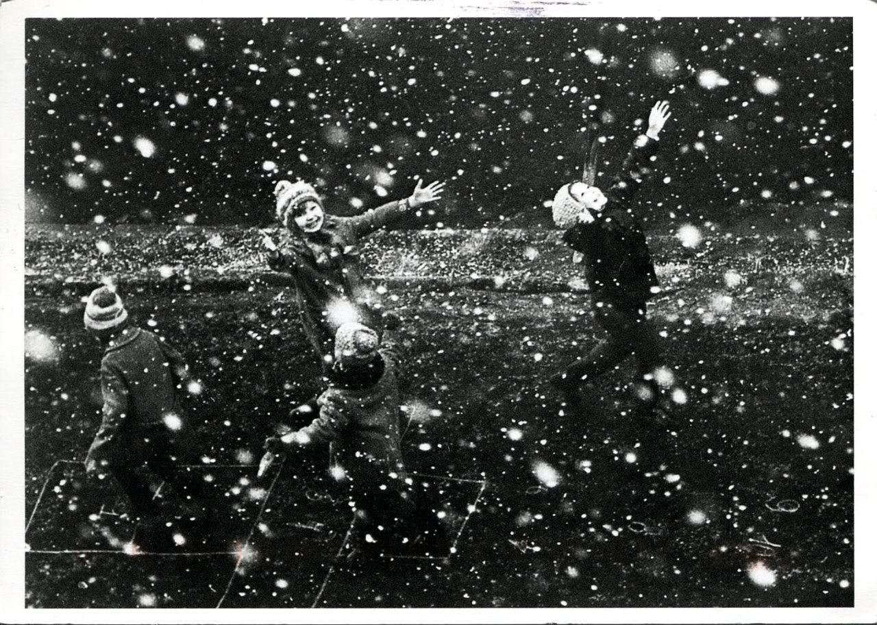 Kids enjoying the first snow. Photography by Vladimir Zotov