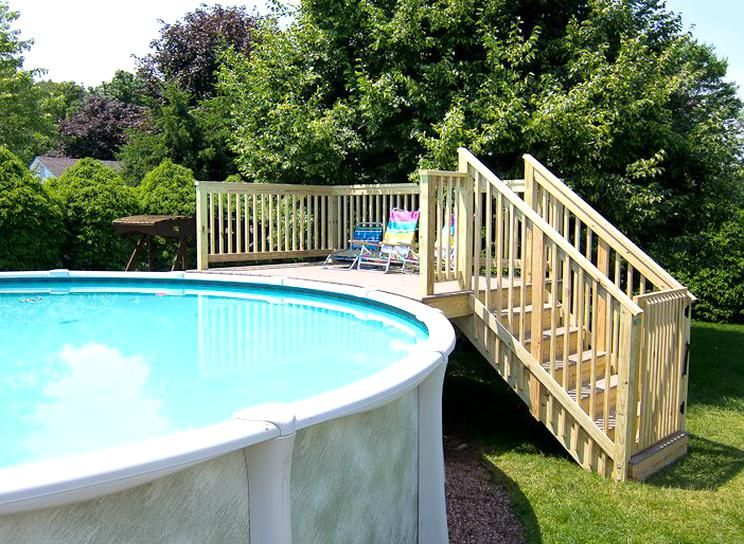 Above The Ground Pool And Hot Tub Deck Pressure Treated Andp Pool Deck And Stairs In Glaston Above Ground Pool Decks Backyard Pool Backyard Pool Landscaping