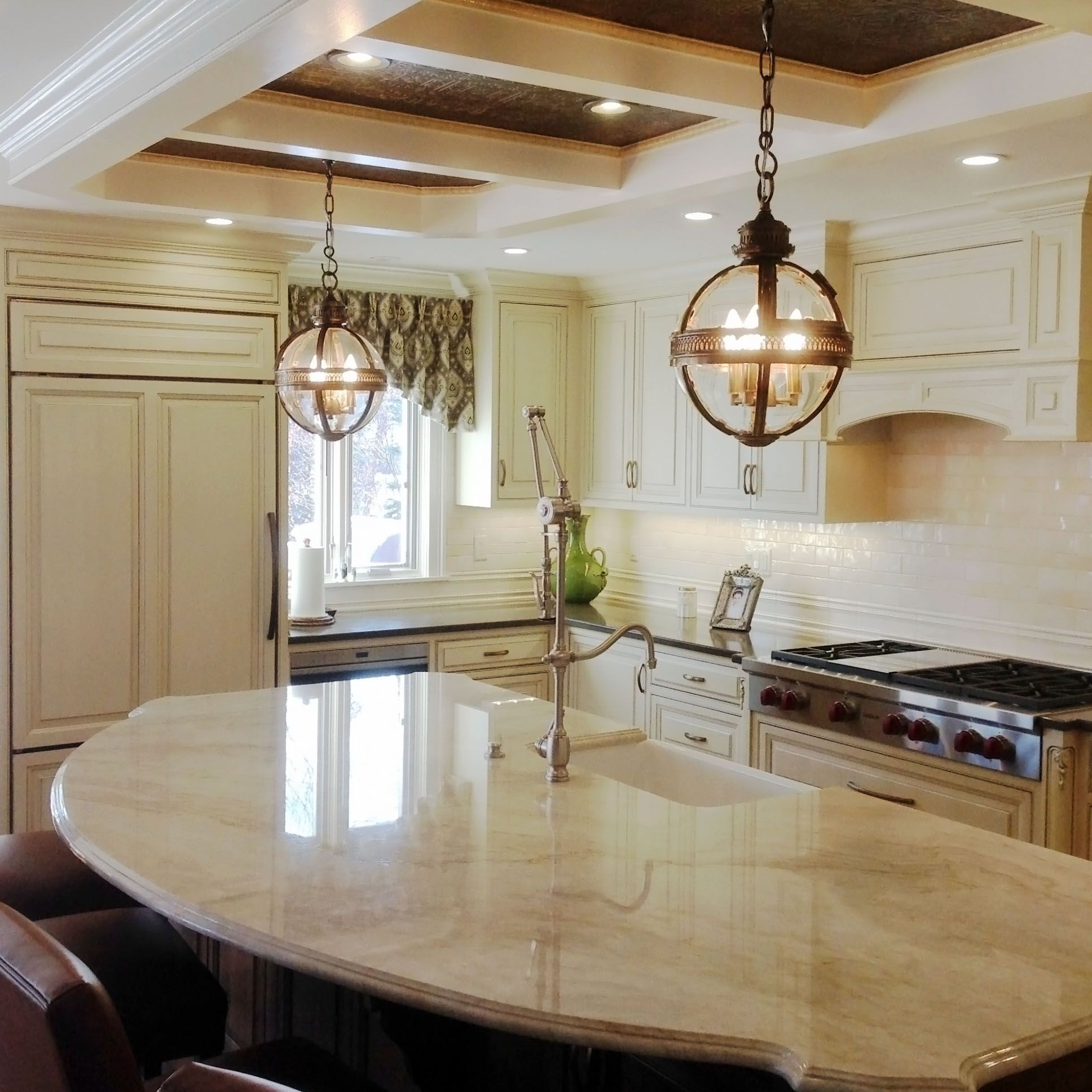 Kitchen island with quartz top - This Alluring Kitchen Showcases Our Taj Mahal Quartzite On The Island The Surrounding Kitchen Countertops Feature Lagos Azul Caesarstone Quartz For A