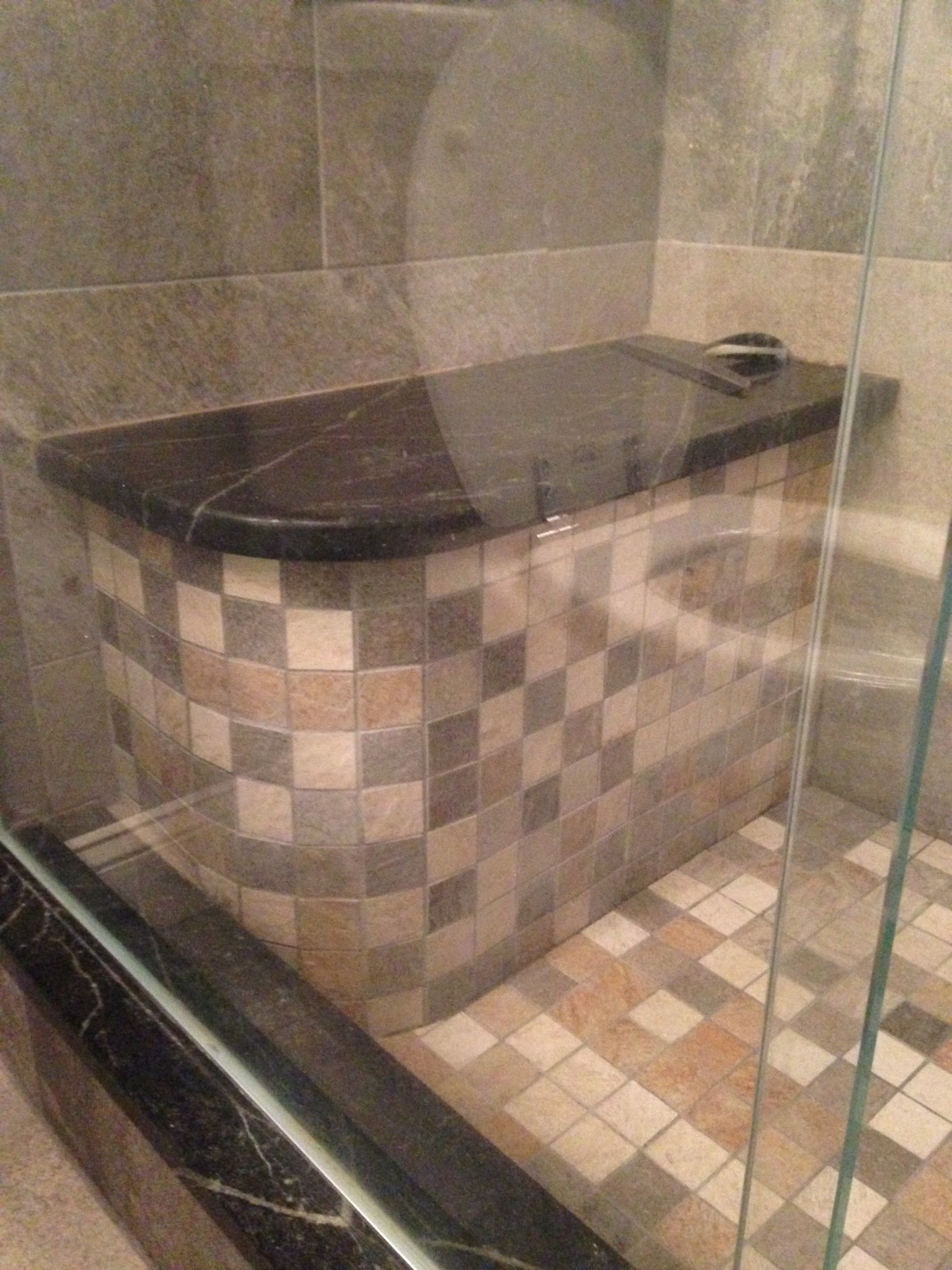 Custom Shower Bench With 2x2 Mosaic Facing And Granite Top.