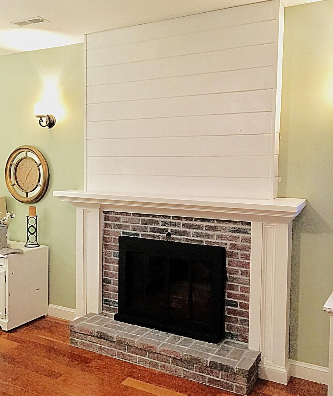 Whitewashed Bricks Shiplap Over Brick Fireplace See This Instagram Photo By Mybeachyfarmhouse Freestanding Fireplace Small Basement Remodel Brick Fireplace