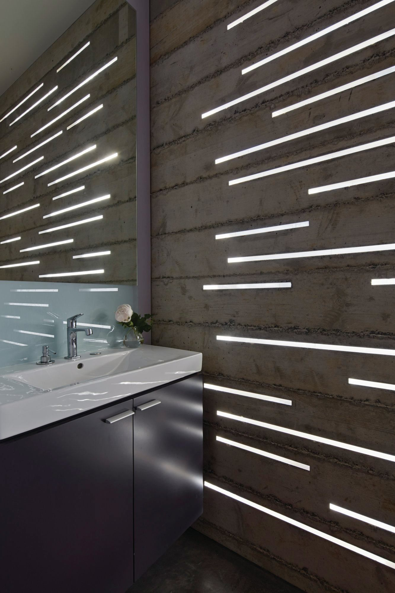 This 27 square foot powder room is lit by