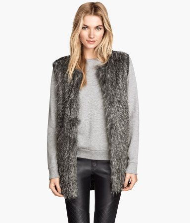0e96489e8 Pull on this soft gray faux fur vest to add sophistication to any ensemble.