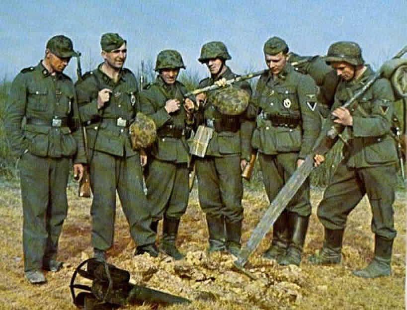 German World War 2 Colour German Soldiers Inspect A Dud ...