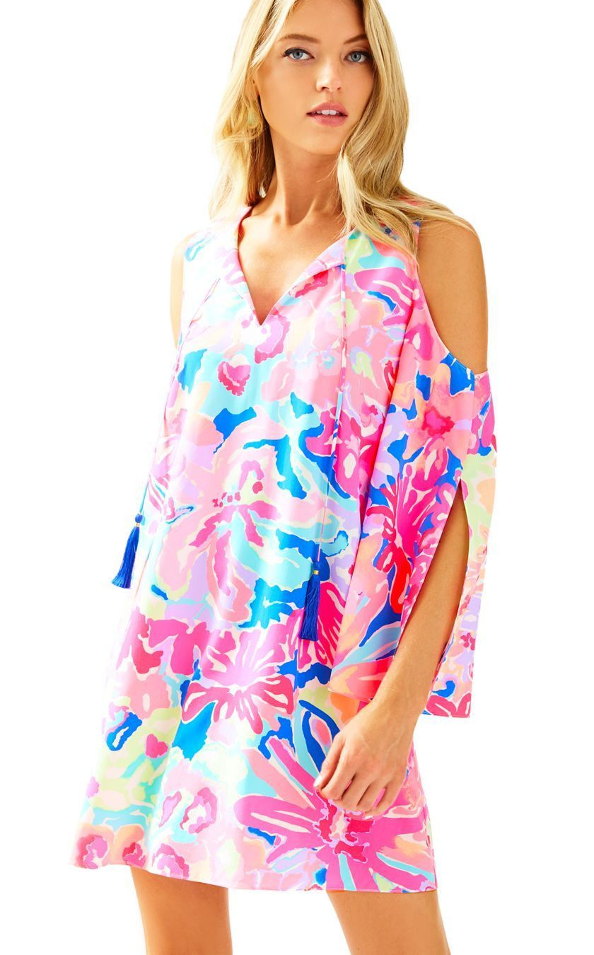 ddee88c8e152 The Lilly Pulitzer Benicia Open Shoulder Tunic Dress in Multi Playa Hermosa  is a split sleeve printed tunic dress that is perfect for a night out.