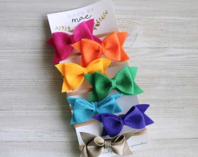 A handmade rainbow set of bows, complete with its own pot of gold faux leather bow!