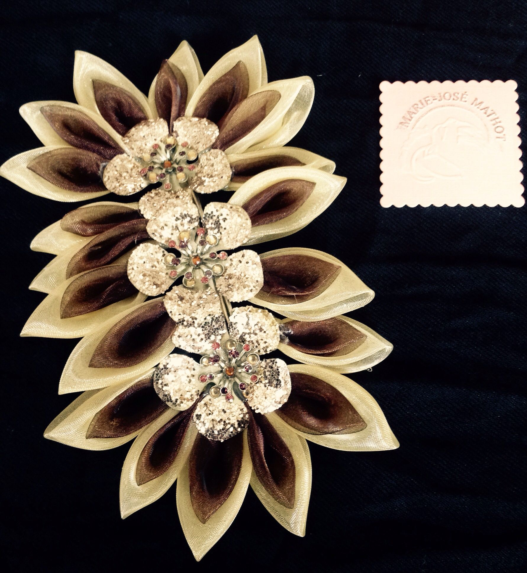 Kanzashi in yellow/ brown organza with gold.