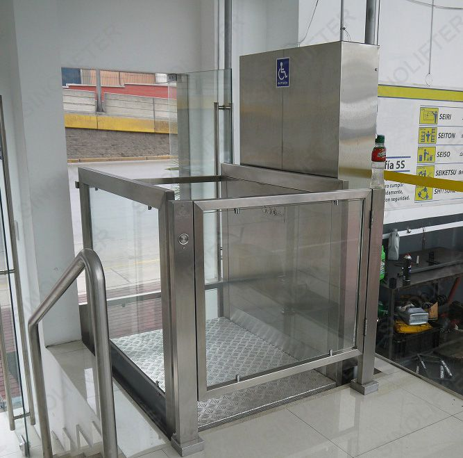 Vertical Wheelchair Lifts : Vertical wheelchair lift with stainless steel appearance