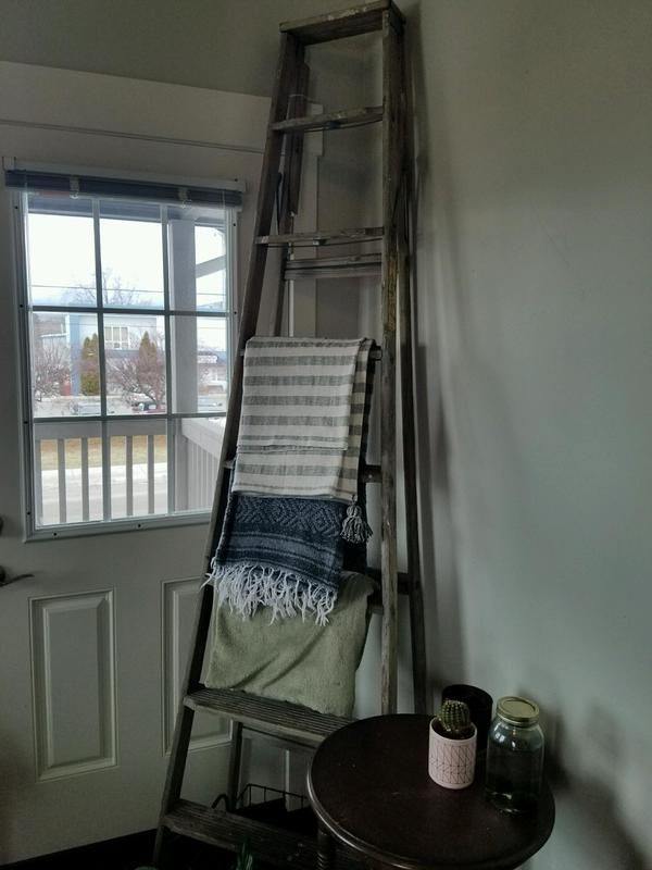 Wooden blanket ladder with various pretty blankets!  Thrift Store Hits || Champagne + Linen