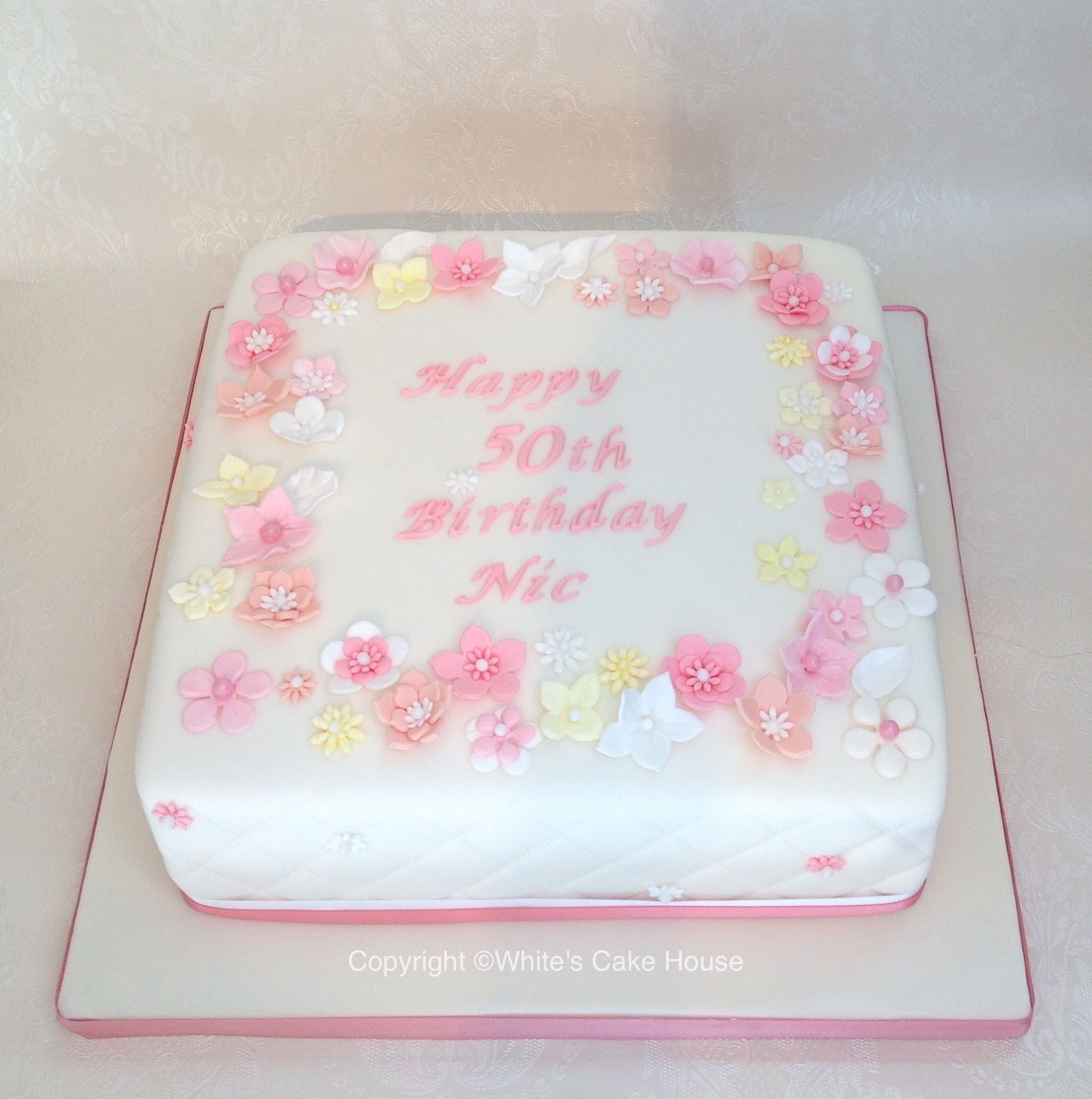 Flower covered birthday cake