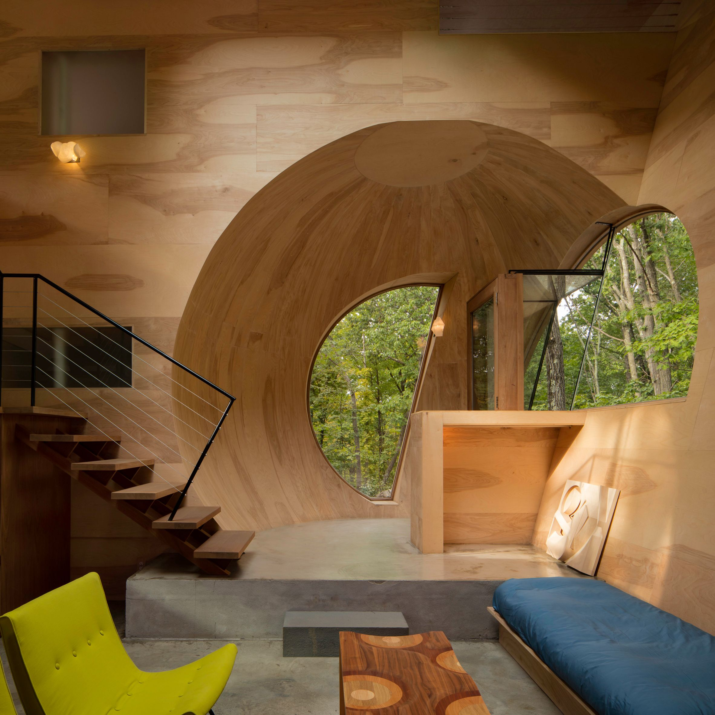 A Japanese House With Trees Growing Through Its Middle And