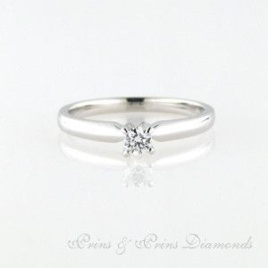 8k white gold ring with one 0.18ct GH VS round brilliant cut diamond set in a 4 claw solitaire setting. 1R05644