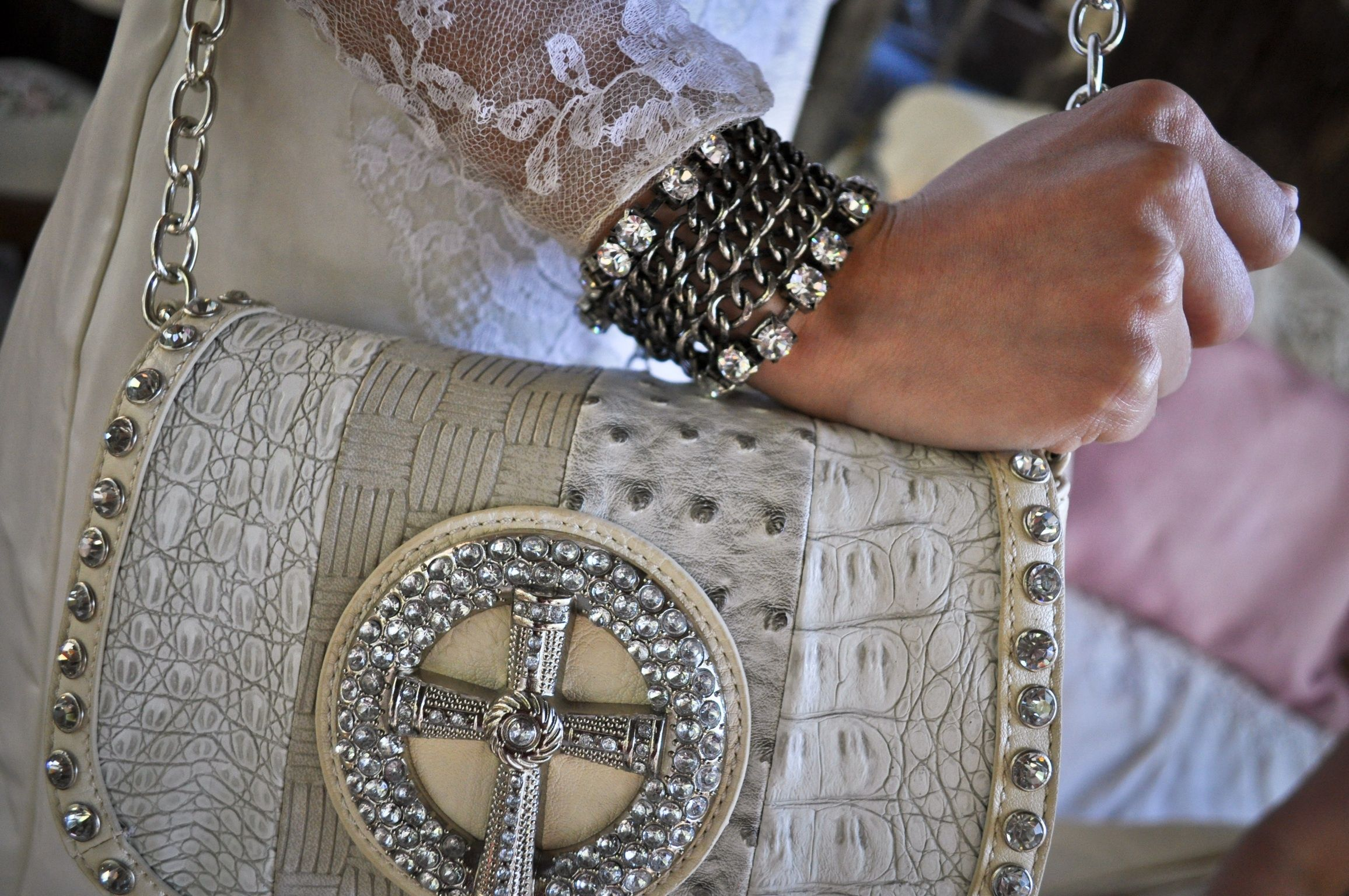 Love this perfect day of the wedding embossed handbag with rhinestone accents accompanied by a industrial chic bracelet.  www.ParisCowgirl.com www.madamPaloozaEmporium.com