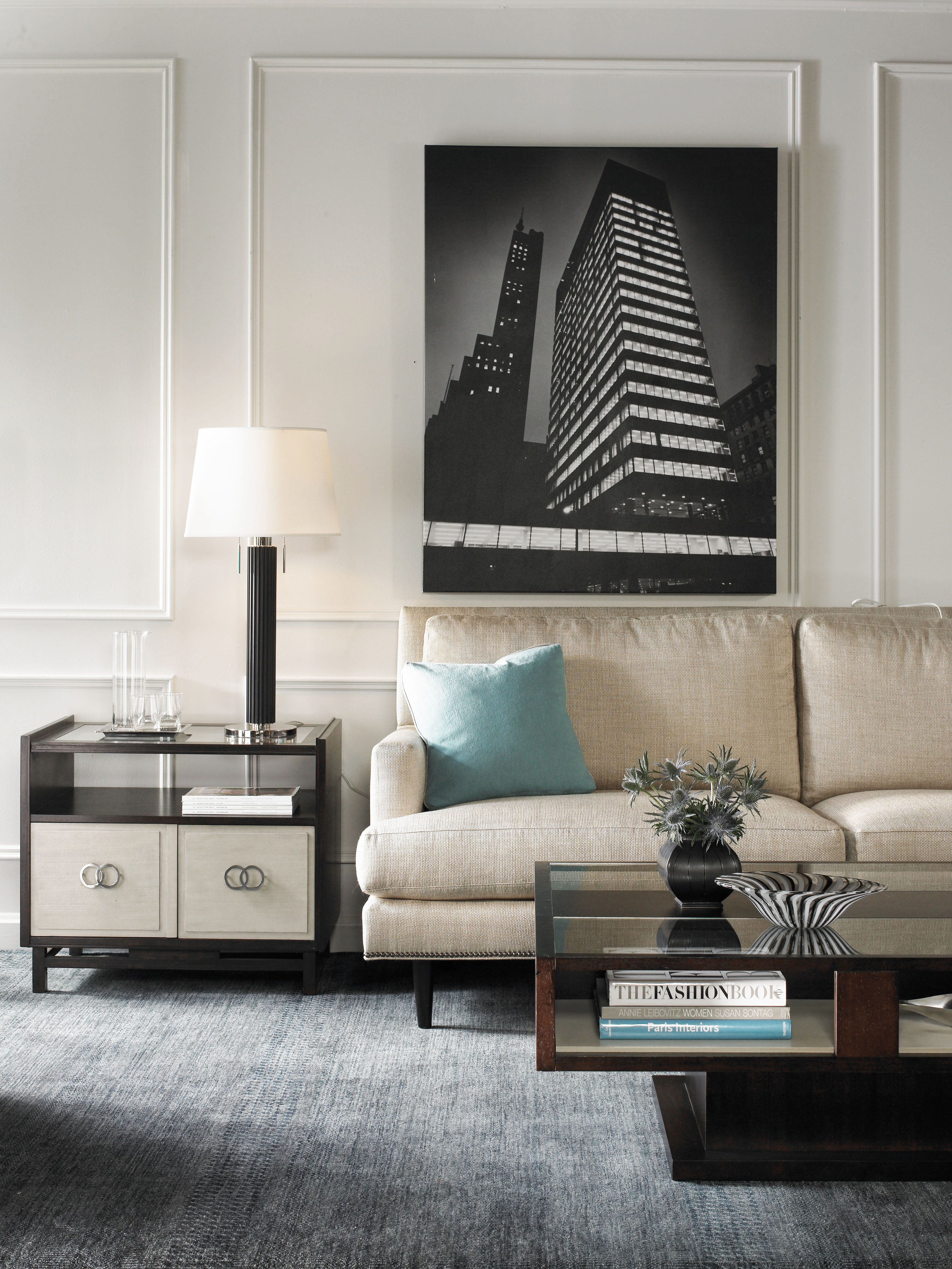 Modern end table with silver hardware and customizable finish upholstered sofa available in a variety of fabrics