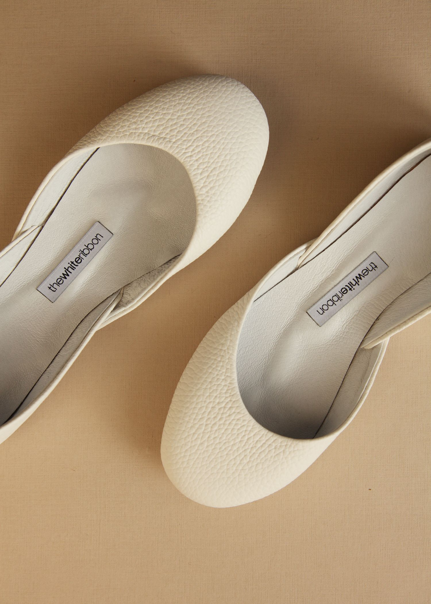 4b50e78b1e3 Handmade from ethically sourced leather, these minimal ivory ...