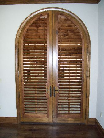 Arched Louvered Doors To Separate Sinks From Bedroom Area British Colonial Arched Doors Home Styles