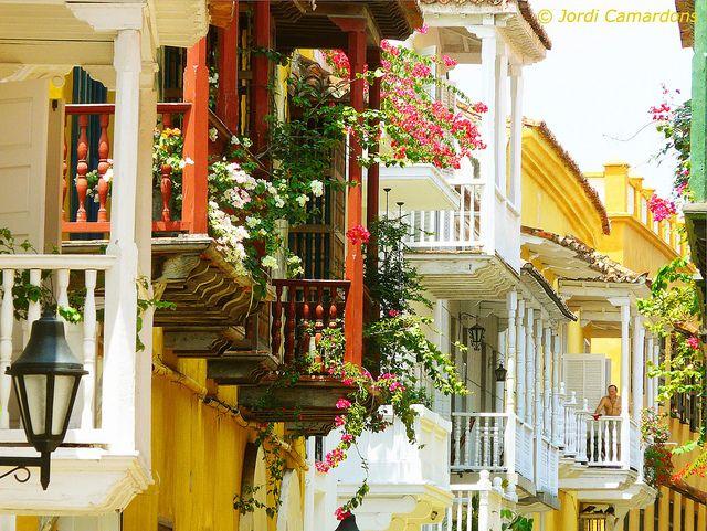 """https://flic.kr/p/7Q1oMu   """"CARTAGENA DE INDIAS"""" (CALLE COLONIAL DEL CASCO ANTIGUO)   Calle del centro  historico colonial  de de la ciudad con sus preciosos balcones de madera  adornados con flores. ( Siglo XVlll y XlX ) COLOMBIA (COPYRIGHT© JORDI CAMARDONS IMAGE ALL RIGHTS RESERVED)"""