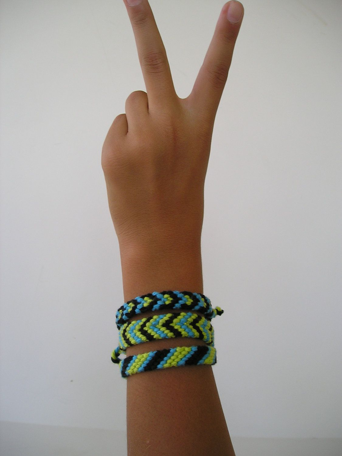 Friendship Braclets Pack of 3 in Green Blue and Black. $6.00, via Etsy.