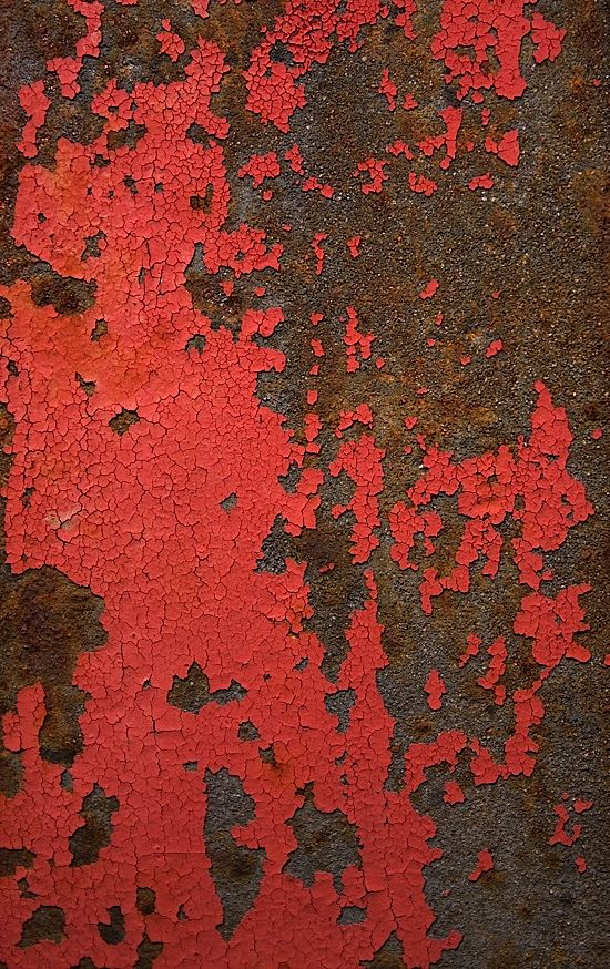 red paint gradually replacedby a deeper organic texture of ochre