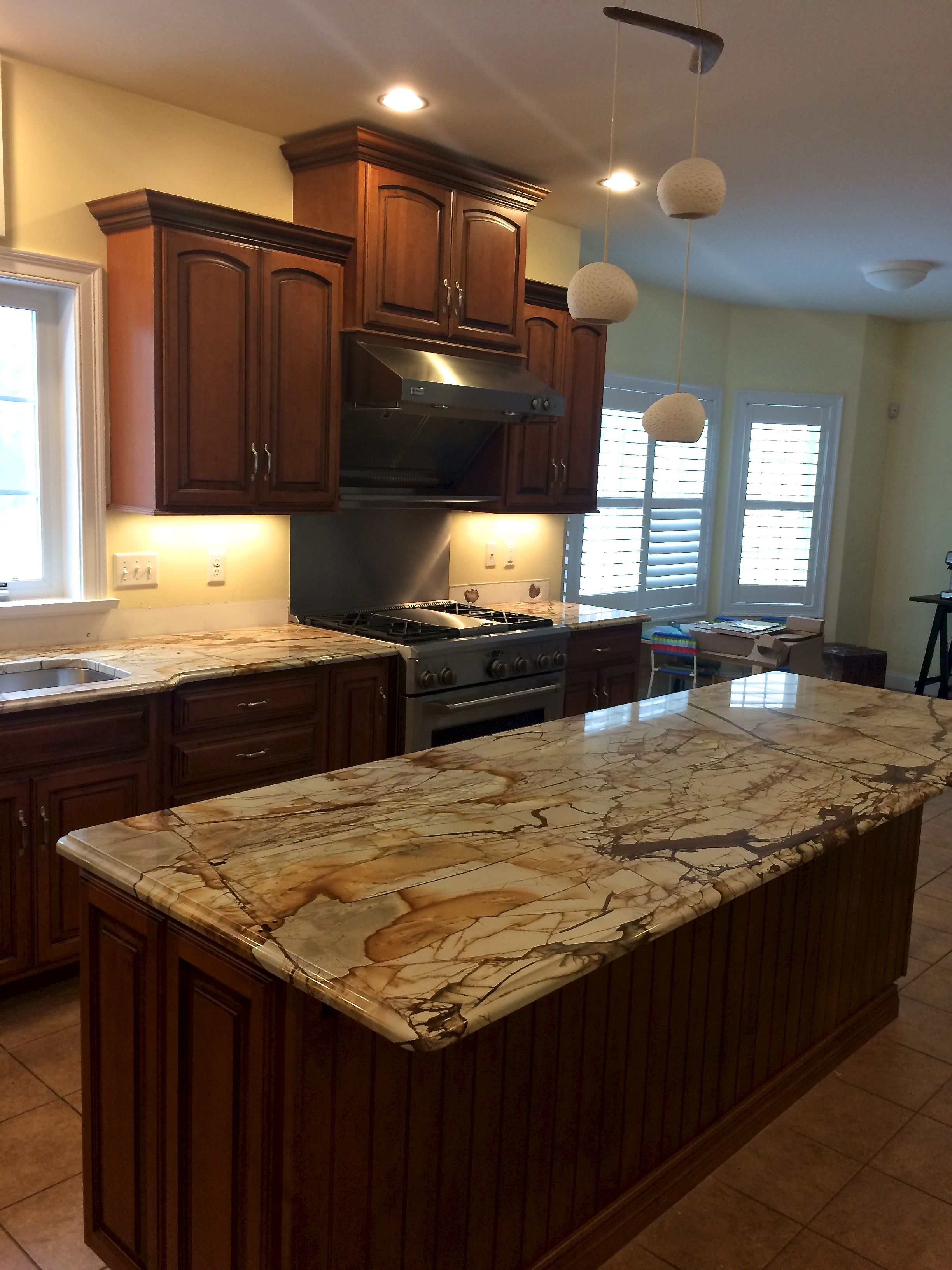 An In Progress Photo Of A Kitchen Countertop Replacement With Beautiful New Roma Imperial