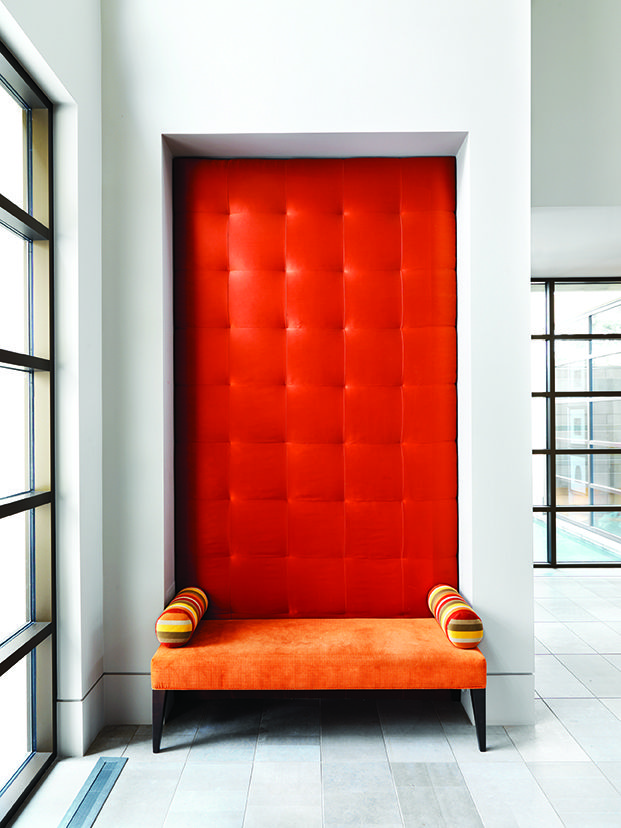 A dramatic punch of orange welcomes visitors in the entrance.