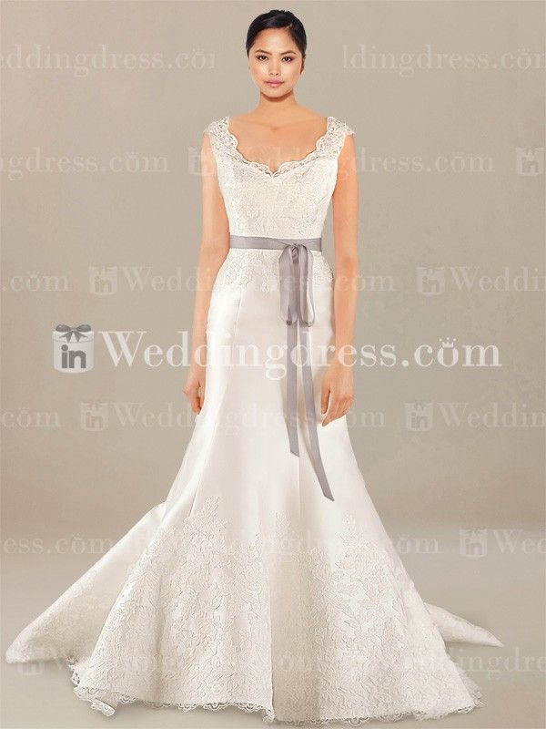 Modest wedding dress is adorned with Lace appliques and scalloped Lace hem.