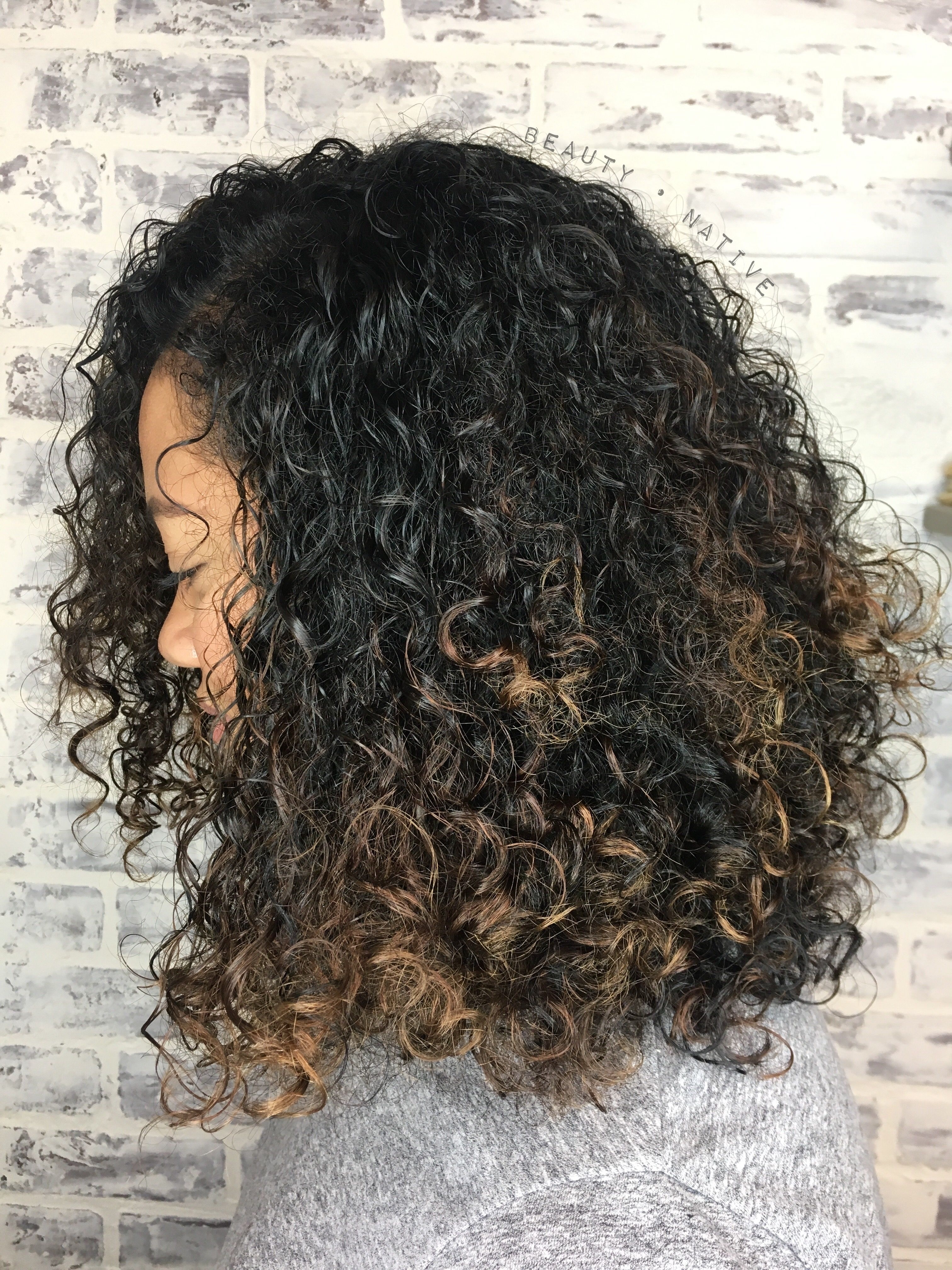 Balayage on natural curly hair.