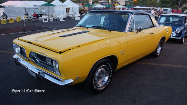 1968 Plymouth Barracuda Convertible sold at Russo and Steele Newport Beach 2014: http://www.specialcarstore.com/content/russo-and-steele-newport-beach-auction-cars-down-sea